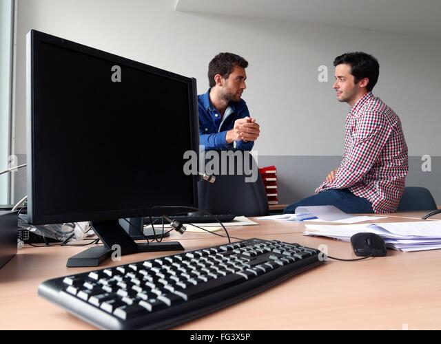 Men At Discussing At Office - Stock Image