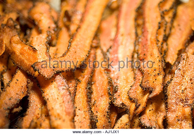 Cooked Bacon with Pepper for sale in a restaurant spiced cooked  golden brown crispy delicious - Stock Image