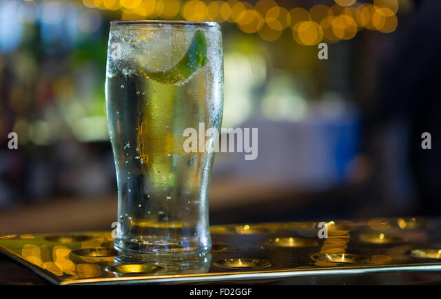 Non alcoholic Lime and Soda drink on a bar in a pub. - Stock Image