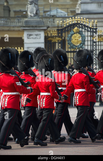Irish Guards guardsmen in ceremonial uniforms 'Changing of the Guard' outside palace Buckingham Palace City - Stock Image