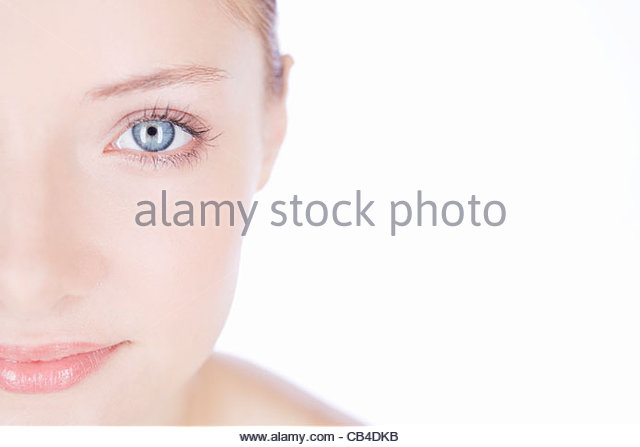 A young woman showing the left half of her face, cropped - Stock Image