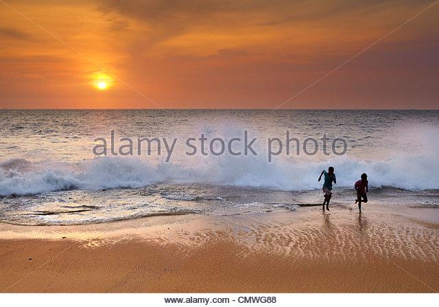 Sri Lanka - children playing on the beach, Koggala Beach - Stock Image