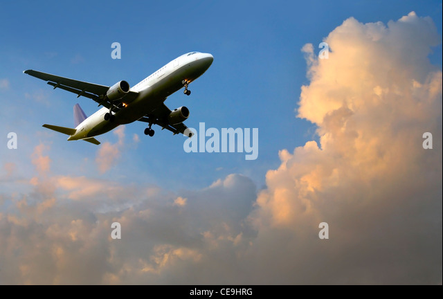 Airplane above the clouds - Stock Image