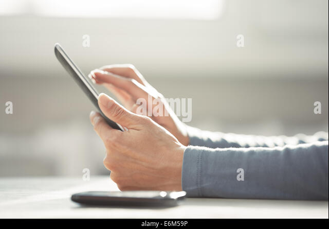 Hands of woman working with digital tablet - Stock-Bilder