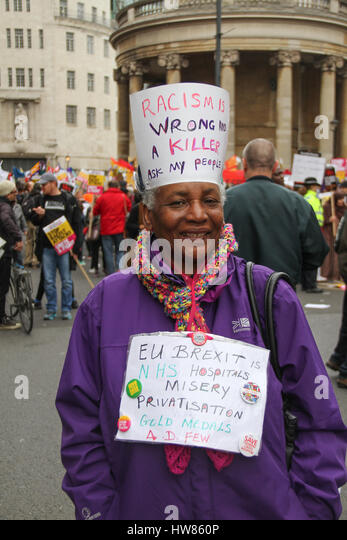 London, UK. March 18, 2017:  A pensioner poses for photos ahed of the Stand Up To Racism demonstration on UN Anti - Stock Image