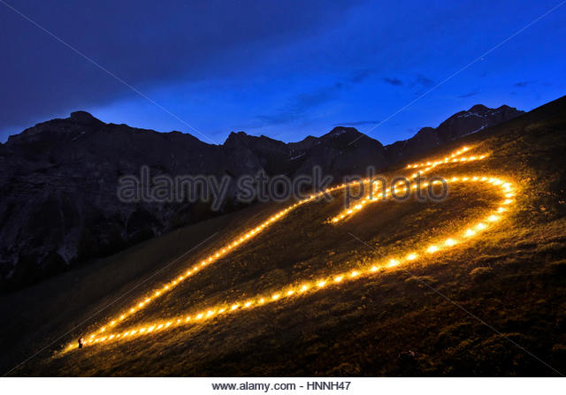 The building and lighting of a sacred heart fire on Elferspitze mountain in the Stubai Valley. - Stock-Bilder