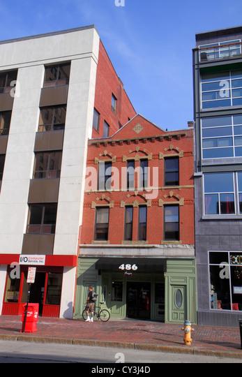 Portland Maine Congress Street historical building red brick between modern buildings preservation - Stock Image