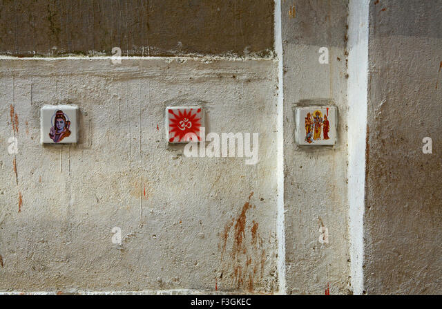 To stop people from spitting images of gods and religious symbols painted ceramicre placed walls public place Mumbai - Stock Image