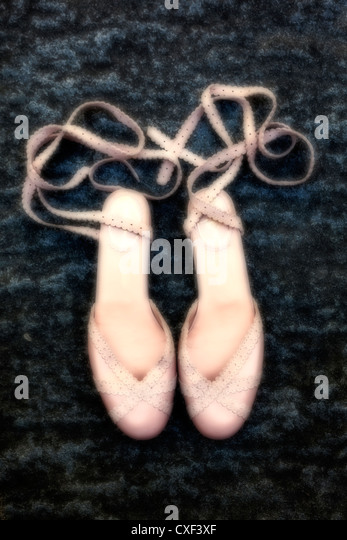 a pair of pink dancing shoes - Stock Image