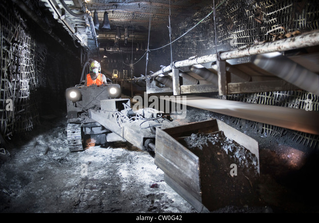 Coal miner working in mine - Stock Image