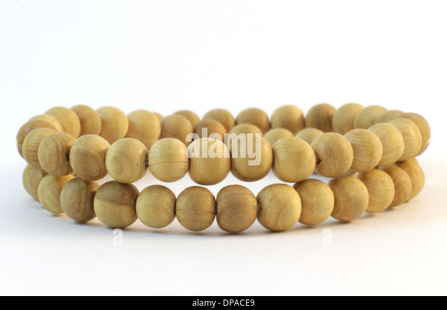 Beeds of Wood on a white background - Stock Image