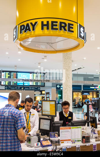 Sydney Australia NSW New South Wales Kingsford-Smith Airport SYD inside interior terminal concourse gate area shopping - Stock Image