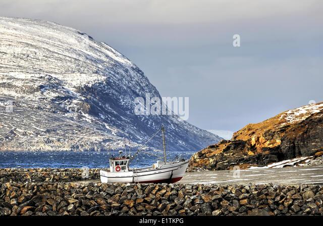 Beached fishing boat Wakeham bay, Quebec, Canada - Stock Image