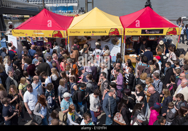 Spanish Food Festival Crowd on the South Bank in London England - Stock Image