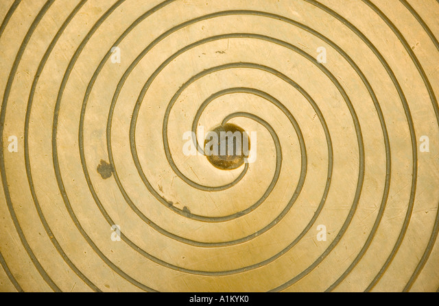 Manhole cover with spiral pattern - Stock Image