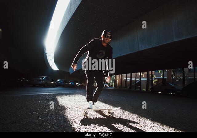 Man Standing On Skateboard - Stock-Bilder