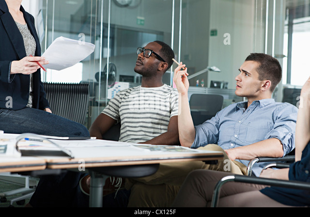 Colleagues planning during creative meeting - Stock Image