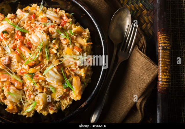 Brown Rice with Bell Peppers, Tomatoes, Ham and Shrimp. - Stock Image