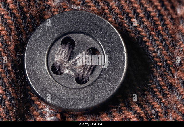 Worn shirt button macro - Stock Image