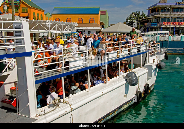 Grand Cayman George Town  cruise ship ferry tender tourists - Stock Image