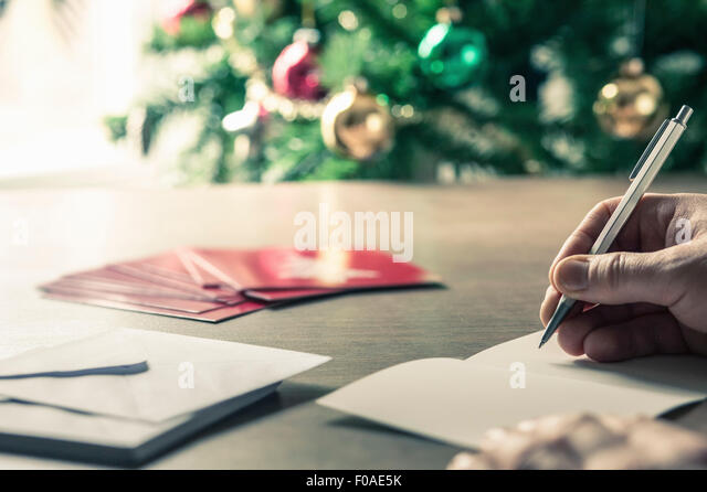 Person writing christmas cards - Stock Image