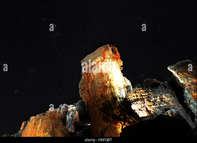 Beautiful rock formations under the stars in Kagga Kamma, Western Cape, South Africa. - Stock Image