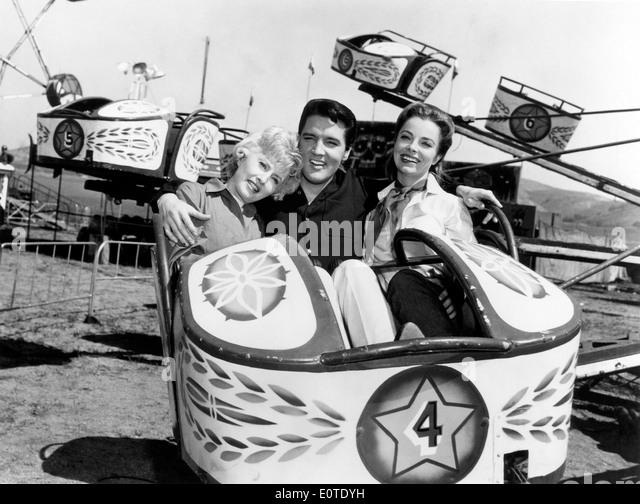 Barbara Stanwyck, Elvis Presley & Joan Freeman, on-set of the Film, 'Roustabout', 1964 - Stock Image