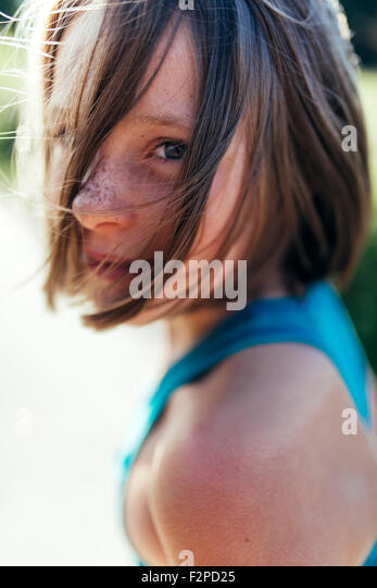 Portrait of girl with brown hair and freckles - Stock Image
