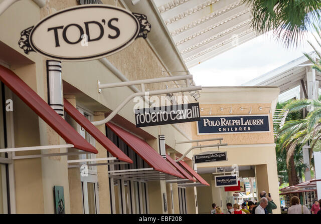 Orlando Florida Premium Outlets shopping Tod's Roberto Cavalli Polo Ralph Lauren Children signs competing brands - Stock Image