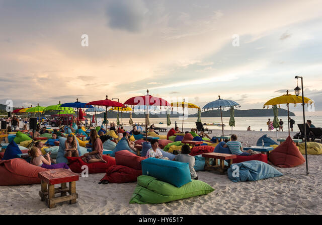 LANGKAWI, MALAYSIA - JANUARY 19, 2017: Tourists enjoy a drink in a beach bar on Cenang beach in Langkawi, an island - Stock Image