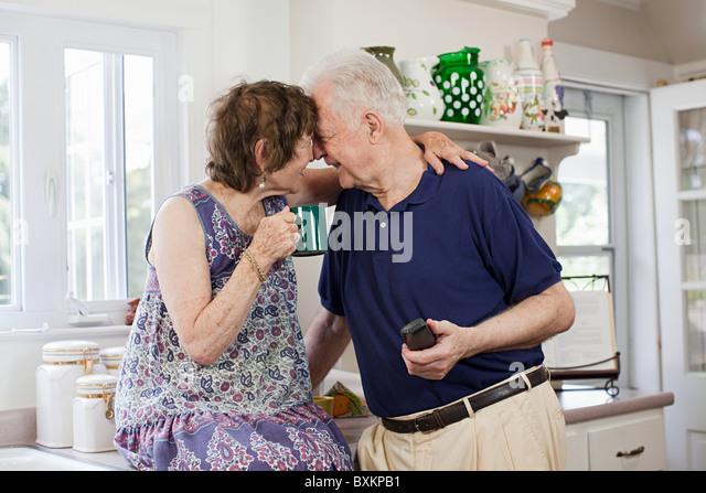 Senior couple in kitchen - Stock-Bilder
