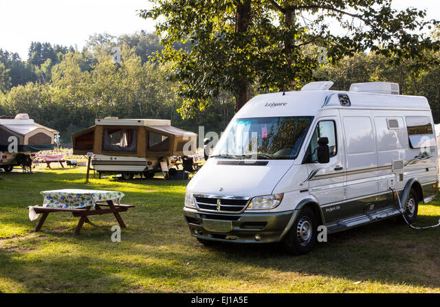 Fishing rv camping stock photos fishing rv camping stock for Camping jardin de mon pere