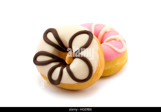 Tasty doughnuts with icing on white background - Stock Image