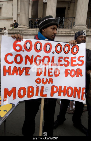 Congolese demonstrate to draw attention to the exploitation of their country for coltan used in mobile phones - Stock-Bilder
