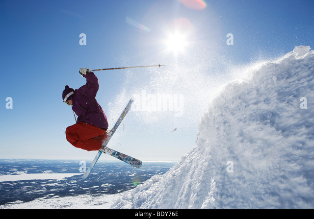 Man in purple getting air-time. - Stock Image