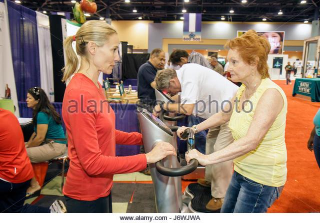 Miami Beach Miami Florida Beach Convention Center centre Health and Fitness Expo exhibitors woman - Stock Image
