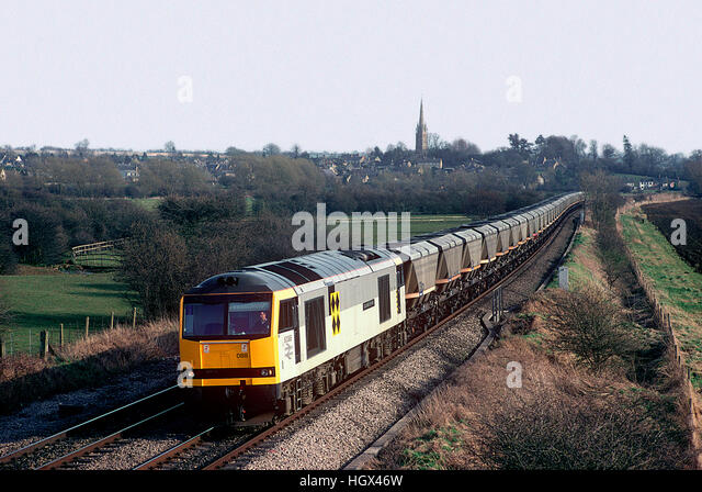 60088 heads north with an empty MGR from Didcot Power Station. Kings Sutton. 1st April 1995. - Stock Image