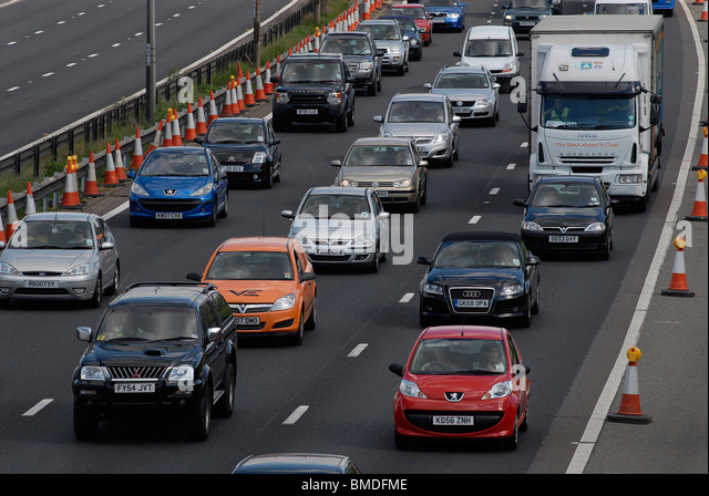Bank holiday traffic near Luton. Coned off hard shoulder with no roadworks going on whilst new UK government decides - Stock Image