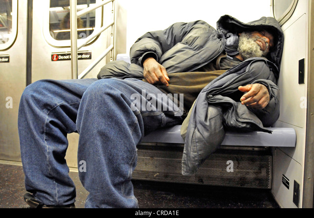 homeless sleeping in the Metro, USA, New York City, Manhattan - Stock-Bilder