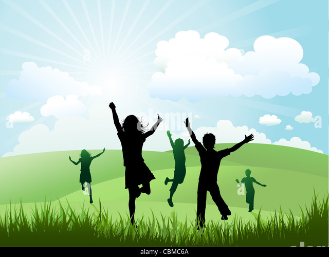 Silhouettes of children running and playing on a hill - Stock Image