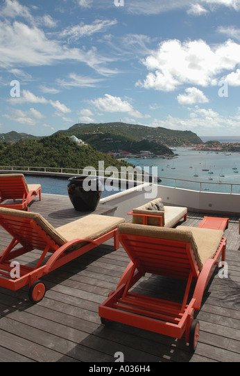 St Barths Private Villa pool lounge chairs overlooking gustavia harbor - Stock Image