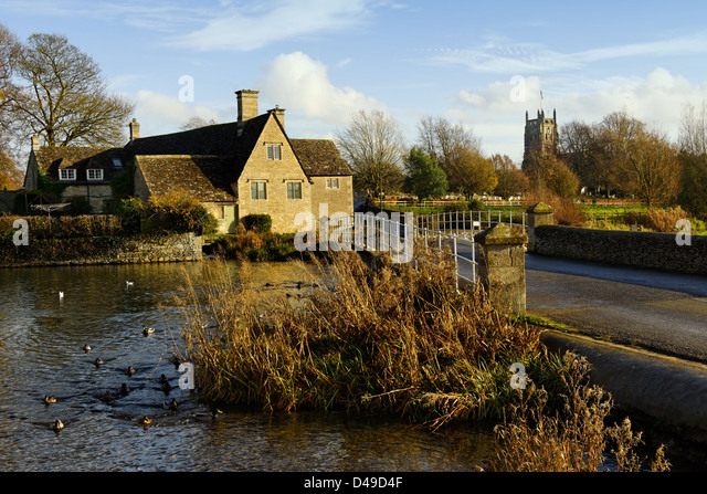 The 17th century mill House on the river Coln, Fairford, Gloucestershire - Stock Image
