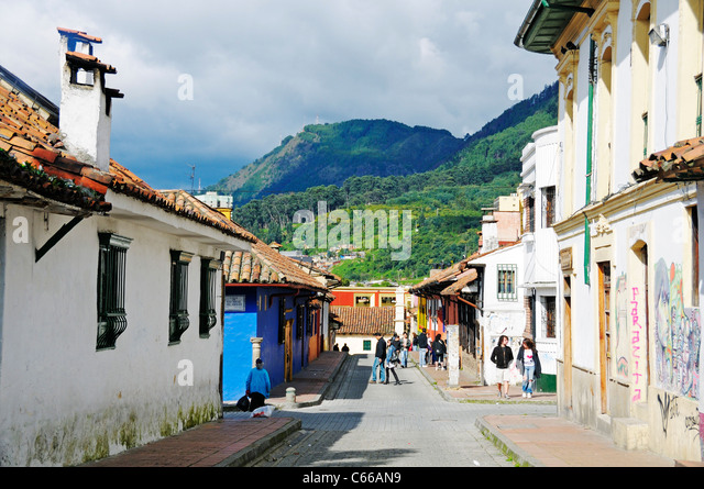 People walking in alleyways at old town, in the back mountains of the cordilleras, La Candelaria quarter, Bogota, - Stock Image