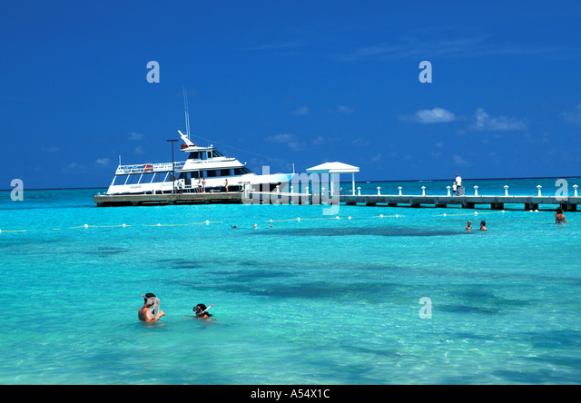 Grand Cayman Island West Indies Caribbean Rum Point Ferry and snorkelers - Stock Image