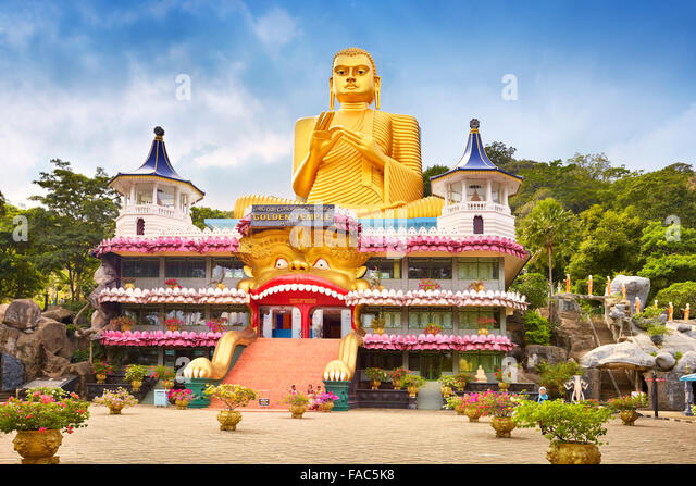 Sri Lanka - Dambulla, Golden Buddha statue over the Buddish Museum, UNESCO World Heritage Site - Stock Image