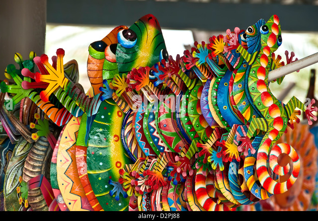Colorful toy iguana souvenirs shopping, Willemstad, Curacao - Stock Image