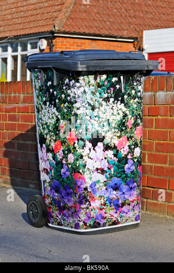 Hand decorated domestic  rubbish 'wheelie  bin' waiting outside house for refuse collectors, - Stock Image