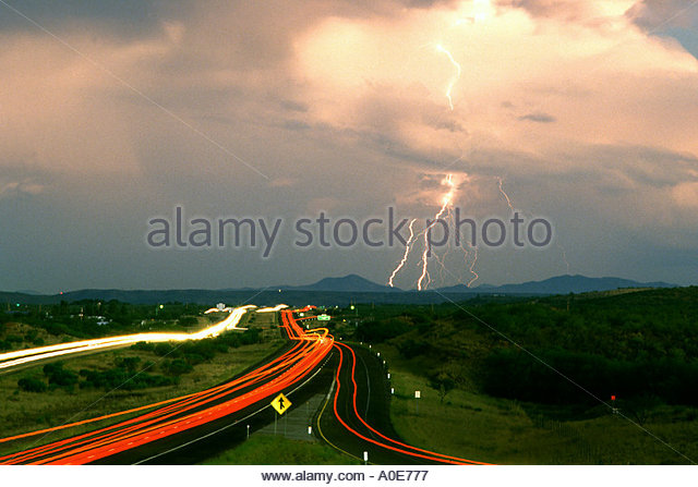 Lightning storm and Interstate 19 headed south toward Mexico - Stock Image