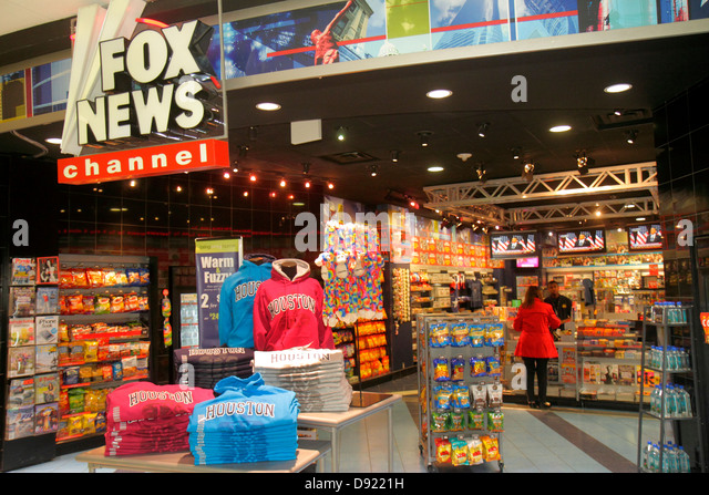 Texas Houston George Bush Intercontinental Airport IAH concourse gate area shopping front entrance retail display - Stock Image