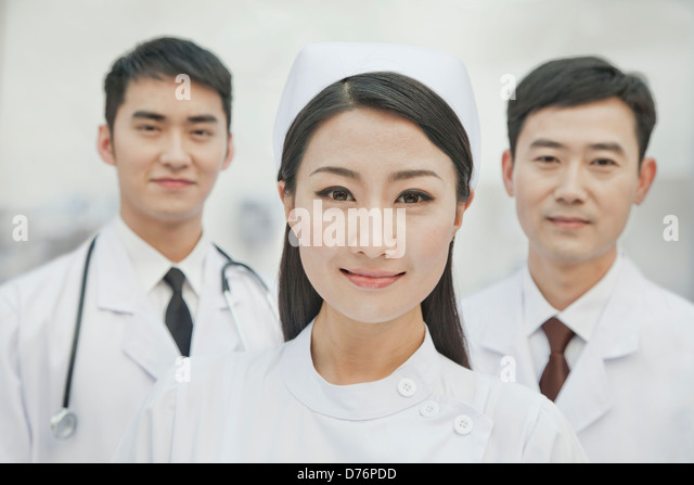 Portrait of Healthcare workers in China, Two Doctors and Nurse - Stock Image